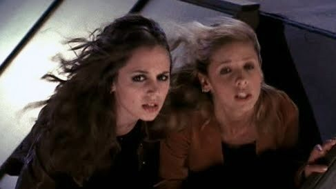 Faith and Buffy, windblown by a helicopter