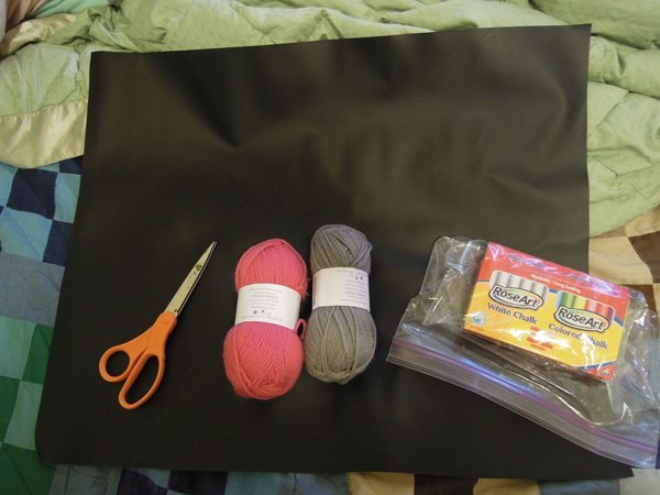 Everything you need for chalk cloth coasters - chalk cloth, scissors, yarn, and chalk.