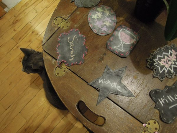 Close-up of some of the coasters and the cat
