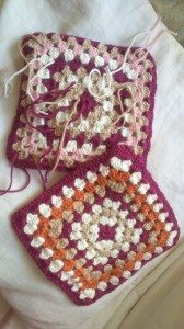 crochet squares; one with yarn ends hanging down