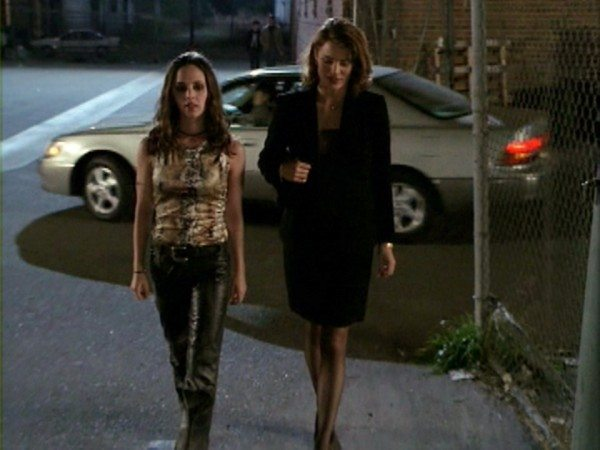 Faith and Liliah walk down the street