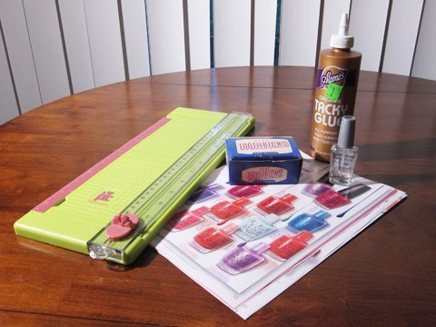 Paper Beads Supplies: paper cutter, catalog, glue, nail polish, and toothpicks
