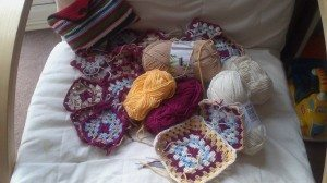 yarn, crochet granny squares of various sizes