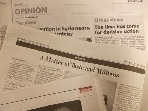 Stack of newspaper opinion pages