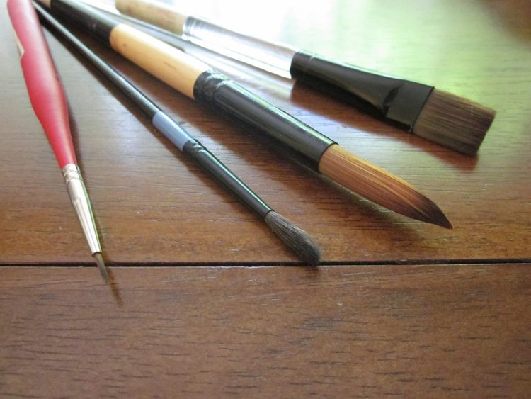 Four watercolor brushes- a liner, a small detail brush, a large round and a large flat