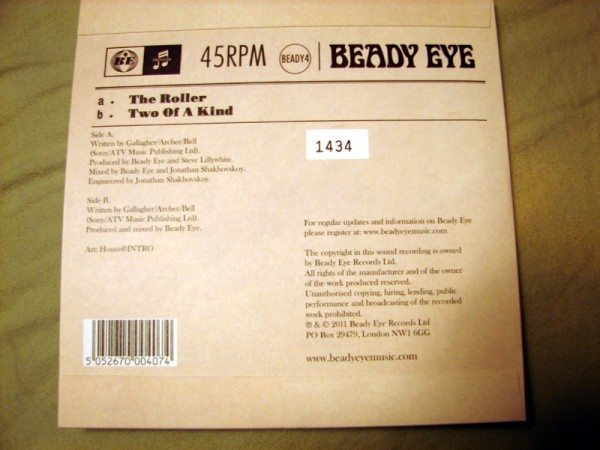 "Back cover of Beady Eye's ""The Roller."""