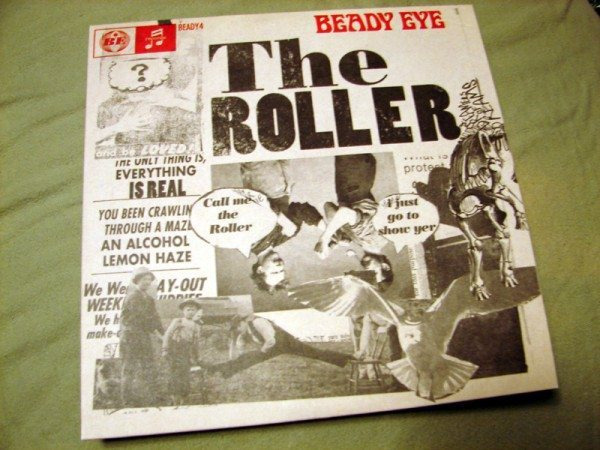 "Front cover of Beady Eye's ""The Roller."""