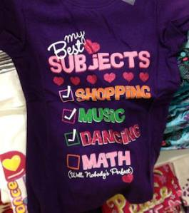 "Purple child's t-shirt that reads ""My Best Subjects: Shopping (check), Music (check), Dancing (check), Math (Well, Nobody's perfect)"