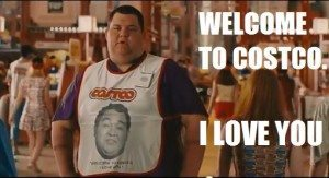 "A person stands wearing a Costco frock and the caption reads ""WELCOME TO COSTCO. I LOVE YOU"" - from Idiocracy (2006)"