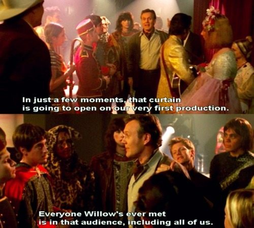 "Giles giving a speech to people in costume - ""In just a few moments, that curtain is going to open on our very first production. Everyone Willow's ever met is in that audience, including all of us."""