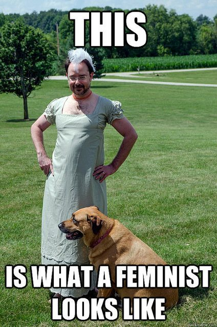 "Picture of a man in a Regency-style dress, captioned ""This is what a feminist looks like."""
