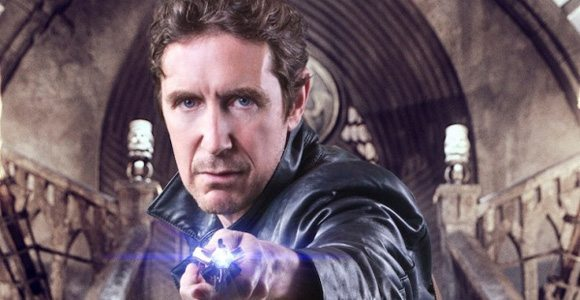 The eighth Doctor from Doctor Who stares at the viewer.