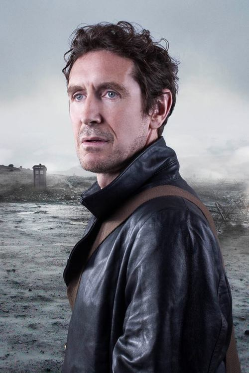 The eighth Doctor from Doctor Who stares into the distance.