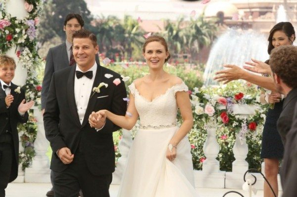 "BONES:  Brennan (Emily Deschanel, R) and Booth (David Boreanaz, L) at their wedding in the ""The Woman in White"" episode of BONES airing Monday, Oct. 21 (8:00-9:00 PM ET/PT) on FOX.  Also pictured background L-R: guest star Ty Panitz, guest star Mather Zickel and Michaela Conlin.  ©2013 Fox Broadcasting Co.  Cr:  Patrick McElhenney/FOX"
