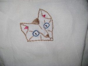 Embroidered cat face