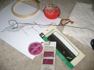 A picture of various embroidery supplies.