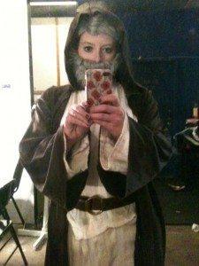 Image of a woman dressed as Obi-Wan Kenobi.