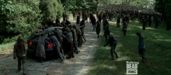 "A horde of walkers surrounds a car in The Walking Dead 4.03 ""Isolation."""