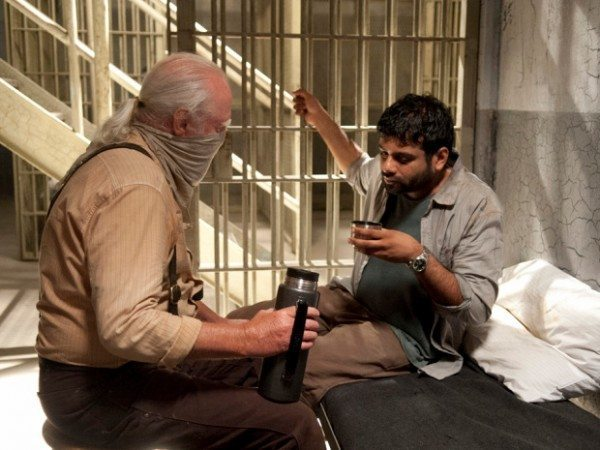"Hershel Greene (Scott Wilson) and Dr. Subramanian (Sunkrish Bala) talk in a jail cell in The Walking Dead 4.03 ""Isolation."""