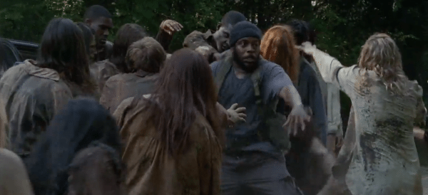"Tyreese (Chad L. Coleman) fights a horde of walkers in The Walking Dead 4.03 ""Isolation."""