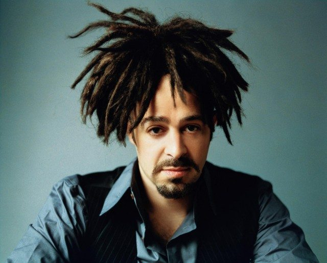 Photo of Adam Duritz from the Counting Crows in a blue shirt and black vest
