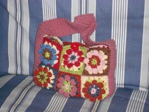 Small granny square crochet bag with button