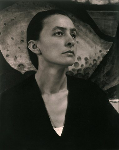 Georgia O'Keeffe knew how to draw the attention to her face, in this case via a long, narrow neckline. (Copyright has expired for this image.)