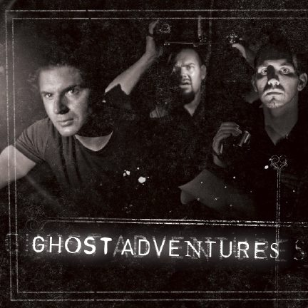 """Zak Bagans, Aaron Goodwin, and Nick Groff of the Travel Channel's """"Ghost Adventures"""" shine lights and hold cameras."""