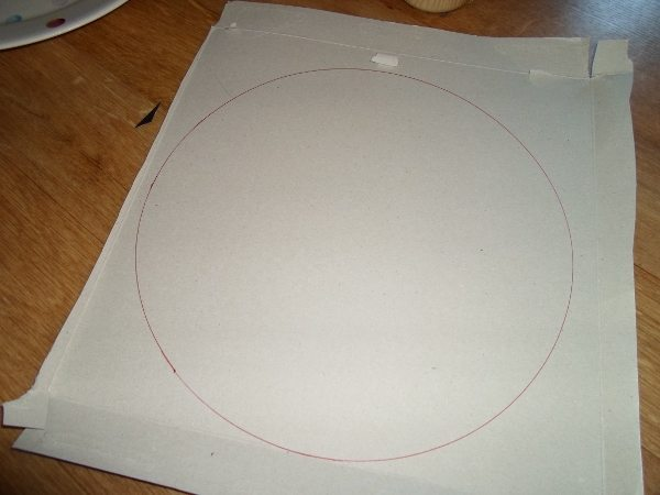 A piece of cardboard with a circle drawn on it.