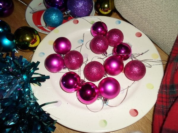 A plate with hot pink baubles.