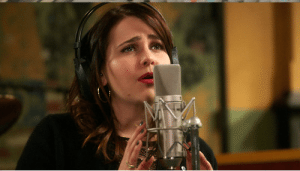 """A still from """"Parenthood"""" episode 5.09 of Amber singing."""