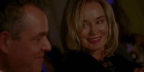 "The Axeman (Danny Huston) and Fiona Goode (Jessica Lange) flirt in American Horror Story: Coven epise 3.06 ""The Axeman Cometh."""
