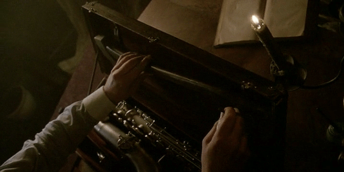 "The Axeman (Danny Huston) puts an axe into his saxaphone case in American Horror Story: Coven episode 3.06 ""The Axeman Cometh."""