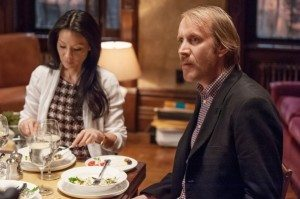 "Mycroft Holmes (Rhys Ifans) and Joan Watson (Lucy Liu) endure Sherlock's antics in CBS's Elementary episode 2.05 ""The Marchioness."""