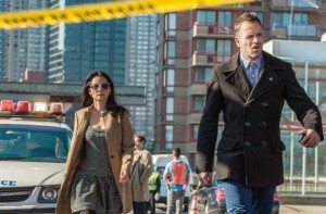 """Joan Watson (Lucy Liu) and Sherlock Holmes (Jonny Lee Miller) arrive to a crime scene in CBS's Elementary episode 2x07, """"This is the Line."""""""