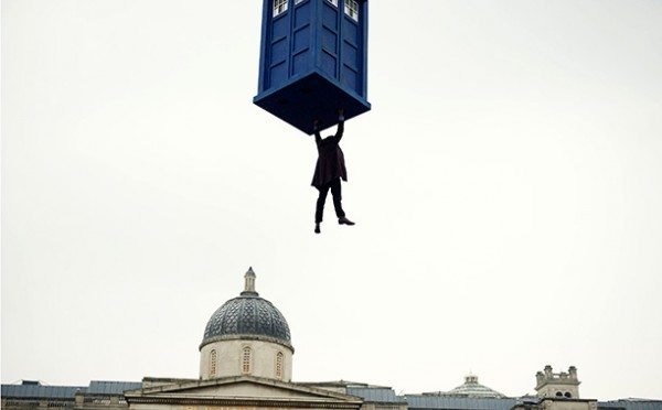 "A still image from ""Day of the Doctor"" of the Eleventh Doctor (Matt Smith) danging from the TARDIS."