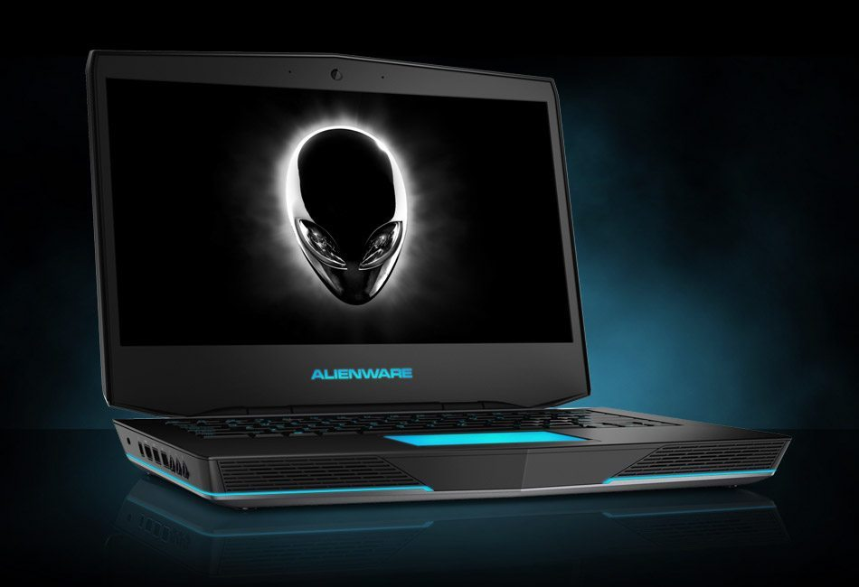 photo of a black Dell Alienware laptop with an alien face on the screen