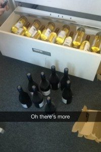 A photo of a drawer filled with wine.