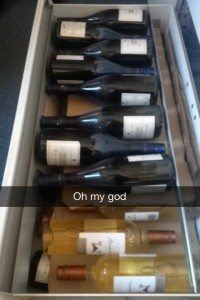 A photo of a drawer full of wine.