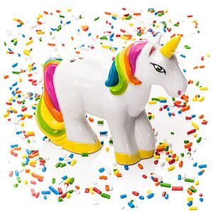 photo of a white plastic unicorn with a gold horn and rainbow mane and tail surrounded by glitter