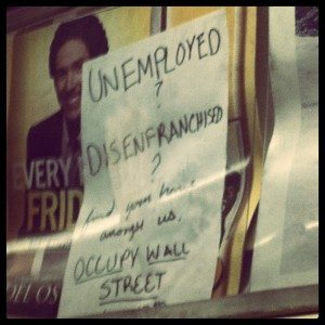 A flyer for Occupy Wall Street posted on a subway train.