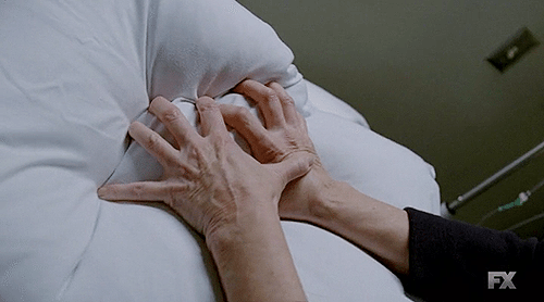 "Screencap of person smothering someone in American Horror Story episoce 3x09, ""Head."""