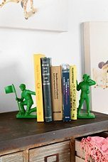 Photo of green army men bookends holding up five books on top of a shelf