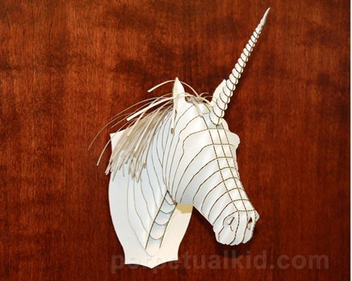 Photo of white cardboard unicorn head for mounting on the wall