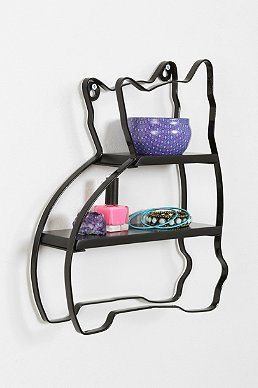 Photo of a metal cat shaped shelf in black with a blue bowl