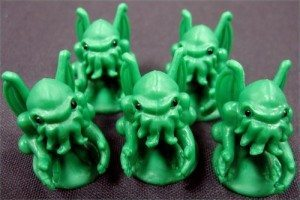 A picture of five green Cthulhu toys.