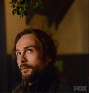 Ichabod Crane (Tom Mison) contemplates some mistletoe.