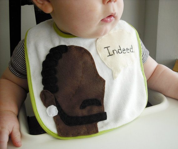 """A baby wearing a bib featuring Omar saying """"Indeed."""""""