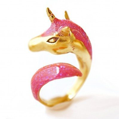 photo of a wraparound gold and pink ring with a unicorn head