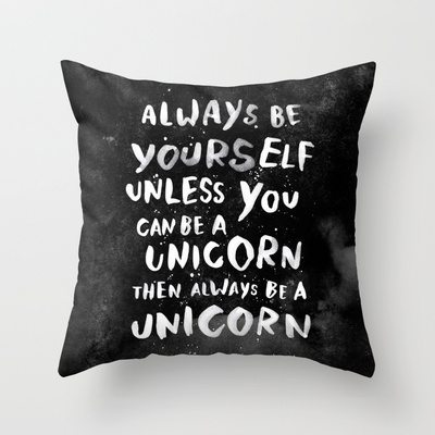 "Black throw pillow with white writing that says ""Always be yourself. Unless you can be a unicorn. Then always be a unicorn"